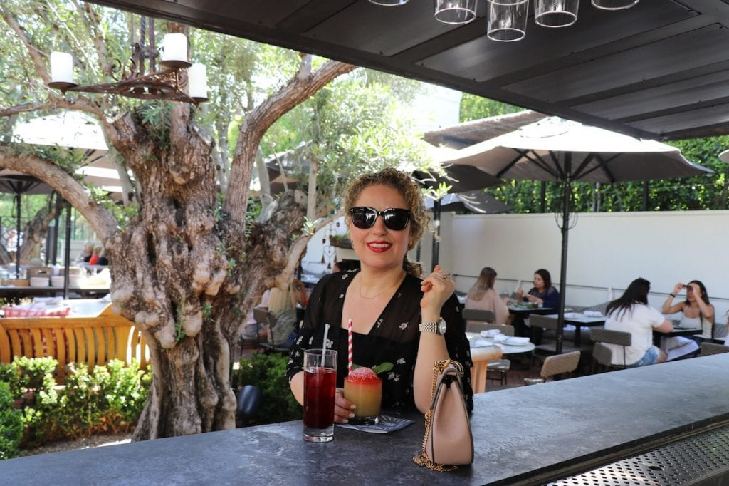 Sustainable Fashion Brands in Los Angeles by Liz in Los Angeles, Lifestyle Blogger, an image of a blond woman in dress