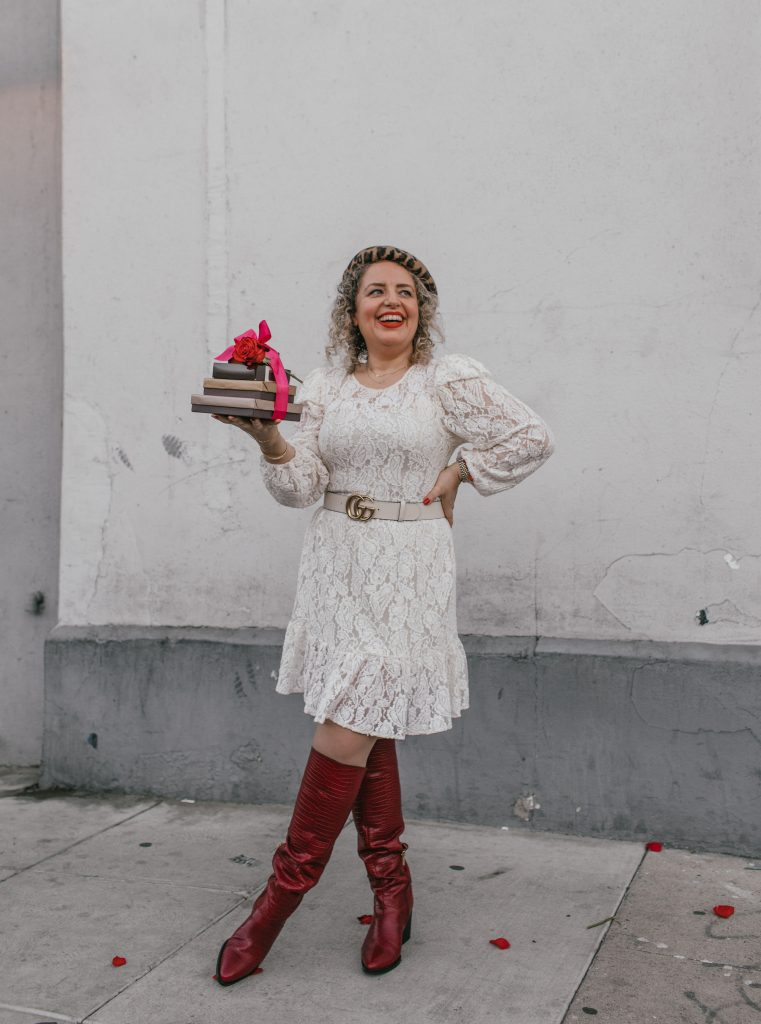 Top 5 Best Artisan Chocolates in Los Angeles, a blog post by Liz in Los Angeles, top Los Angeles blogger, an image of a blonde women wearing a white dress and red boots holding artisan chocolate