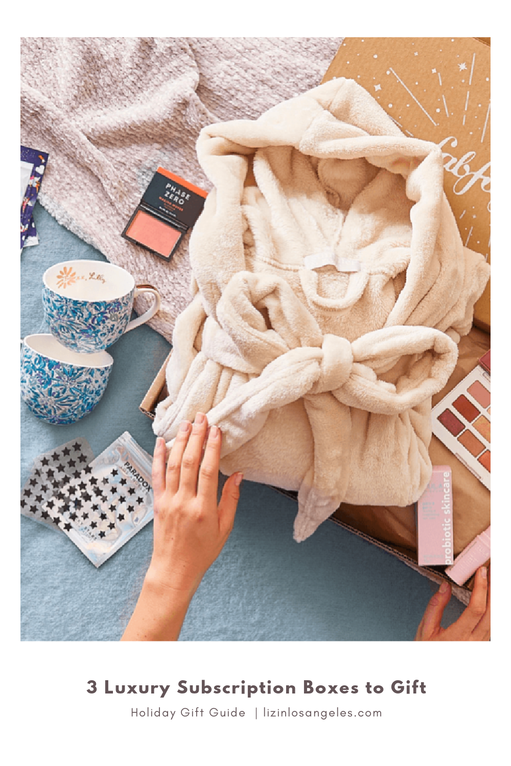 3 Luxury Subscription Boxes to Gift, a blog post by Liz in Los Angeles, top Los Angeles lifestyle blogger, an image of items in a luxury subscription box like a bathrobe and beauty items