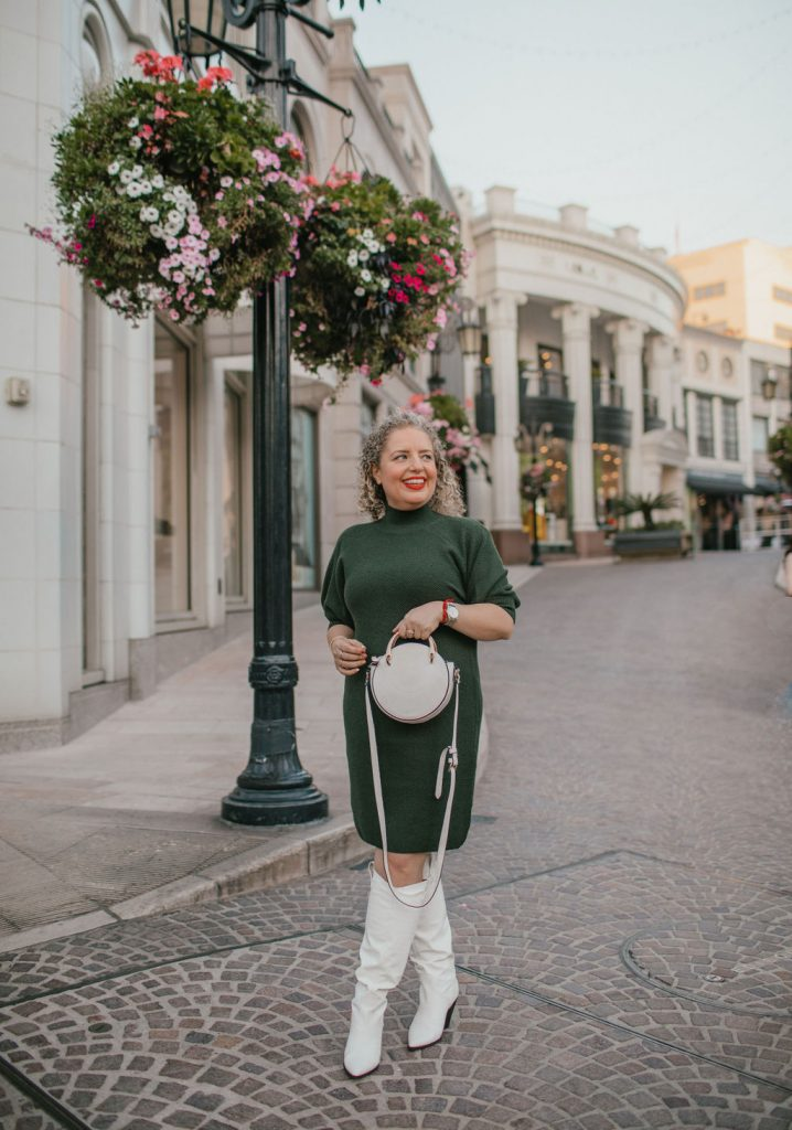 3 Easy New Year's Eve Outfits for Women, a blog post by Liz in Los Angeles, top Los Angeles Fashion blogger, an image of a blonde women in a green sweater dress for the holidays