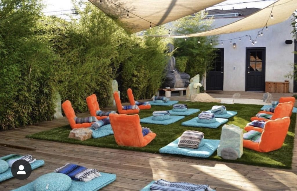 The Best Mediation Classes in Los Angeles by Liz in Los Angeles, Los Angeles Blogger, an image of an outdoor meditation room with colorful chairs