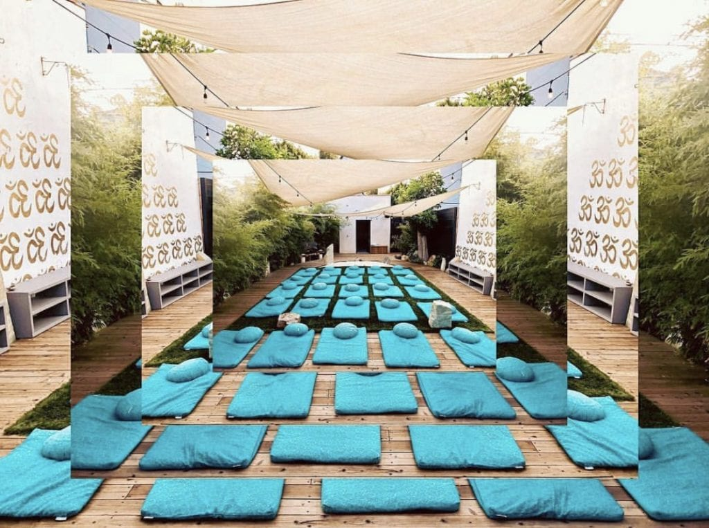 The Best Mediation Classes in Los Angeles by Liz in Los Angeles, Los Angeles Blogger, an image of a meditation room with blue meditation rugs