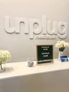Top 5 Meditation Classes in Los Angeles, a blog by Liz in Los Angeles, Los Angeles Blogger, an image of the front desk at a meditation studio