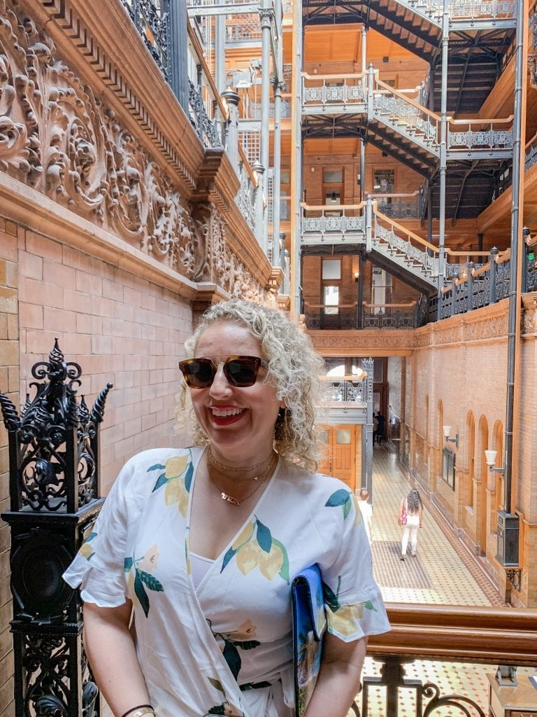 A Walkable Guide to Instaworthy Spots in DTLA y Liz in Los Angeles, a Los Angeles Lifestyle Blogger: image of a blonde women at Brandbury Building