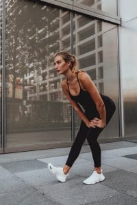 Wellness Tips for The New Year by The Experts, a blog post by Liz in Los Angeles, Los Angeles Lifestyle Blogger, an image of a woman stretching