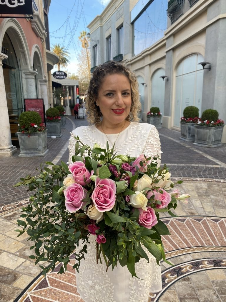 Top Things to Do in LA in February, a blog post by Liz in Los Angeles, Los Angeles Lifestyle Blogger: an image of a blonde women holding flowers