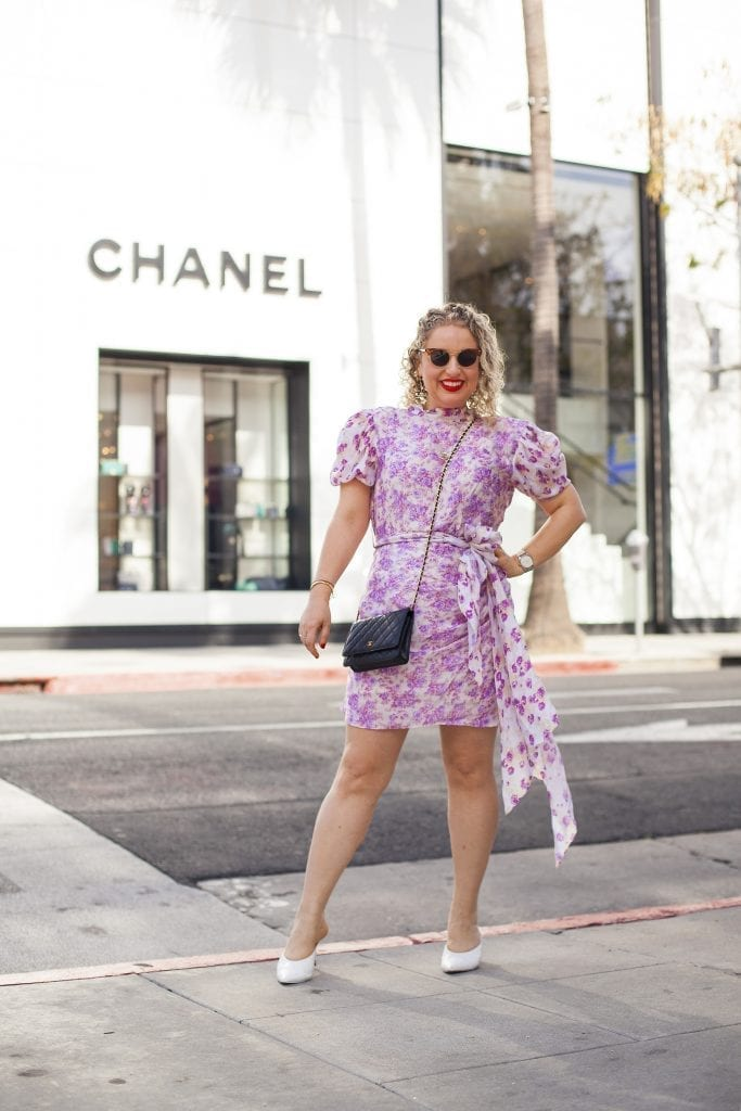 What to Wear in LA in the Spring, a blog post by Liz in Los Angeles; an image of a woman in a floral dress