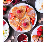 Top 5 Amazing Ideas to Celebrate Mother's Day Virtually, a blog post by Liz in Los Angeles: an image of pancakes in shape of hearts for Mother's Day