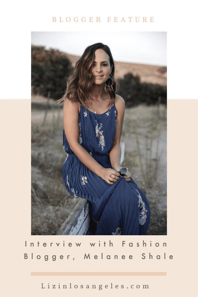 a brunette fashion blogger wearing a blue dress in a field