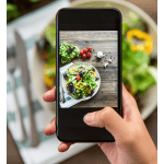 Top 5 Best Photography Editing Apps for iPhones, a blog post by Liz in Los Angeles, a top Los Angeles Influencer: an image of an iPhone taking a picture of food