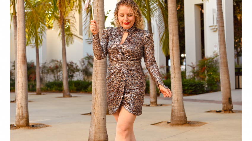 3 Easy New Year's Eve Outfits for Women, a blog post by Liz in Los Angeles, top Los Angeles Fashion blogger, an image of a blonde women in a sequins dress for the holidays