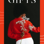 Top 12 Sustainable Made in Los Angeles Gifts, a blog post by Liz in Los Angeles, a top Los Angeles Lifestyle Blogger, an image of a women wearing a red sweater holding flowers