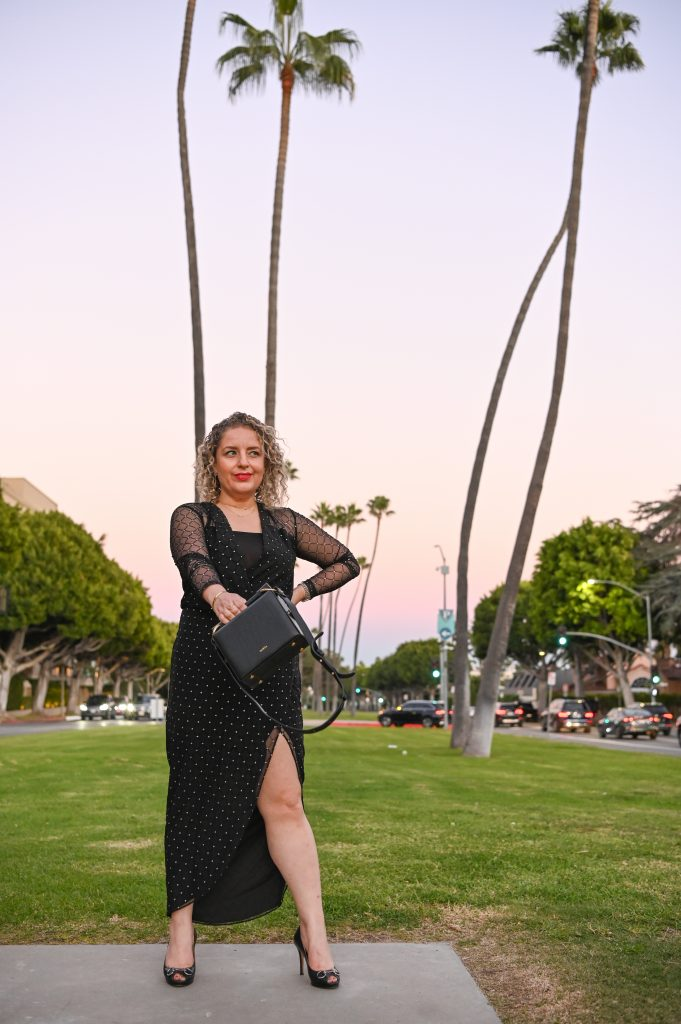 3 Easy New Year's Eve Outfits for Women, a blog post by Liz in Los Angeles, top Los Angeles Fashion blogger, an image of a blonde women in a black dress for the new year's eve