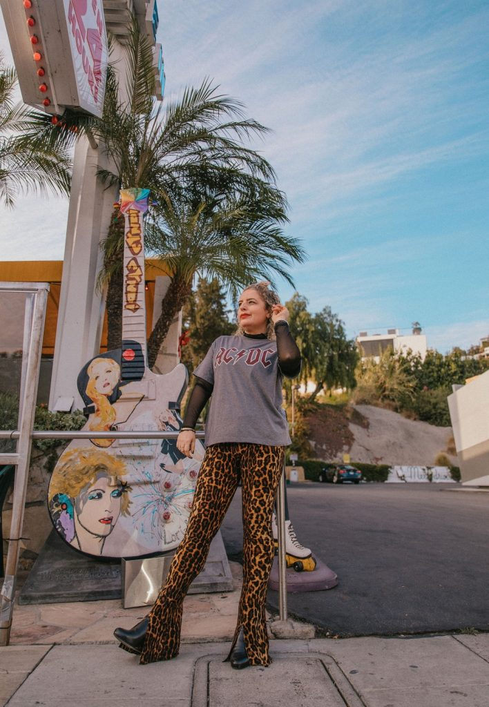 5 Cute and Easy Holiday Looks to Stay Home and Celebrate, a blog post by Liz in Los Angeles, top Los Angeles Lifestyle Blogger, an image of a blonde woman in a 70s style outfit in front of Mel's Drive In