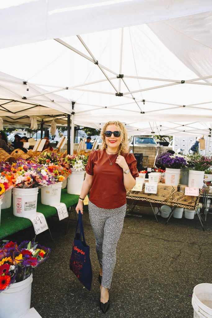 Where to Celebrate Galentine's Day in Los Angeles: 5 Things to Do During Social Distancing, a blog post by Liz in Los Angeles, Los Angeles Lifestyle Blogger, an image of a women at Farmer's Market in Los Angeles