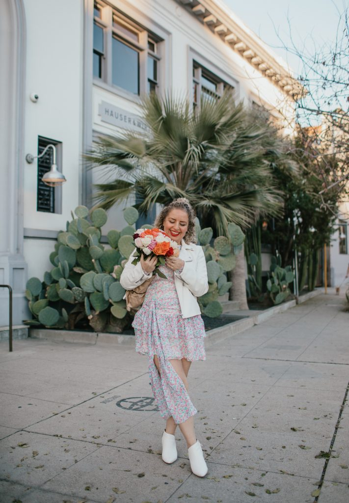 What to Wear on Valentine's Day in 2021_ 3 Cute Outfit Ideas, a blog post by Liz in Los Angeles, top Los Angeles lifestyle blogger, an image of a blonde women in a floral dress with flowers for Valentine's Day:
