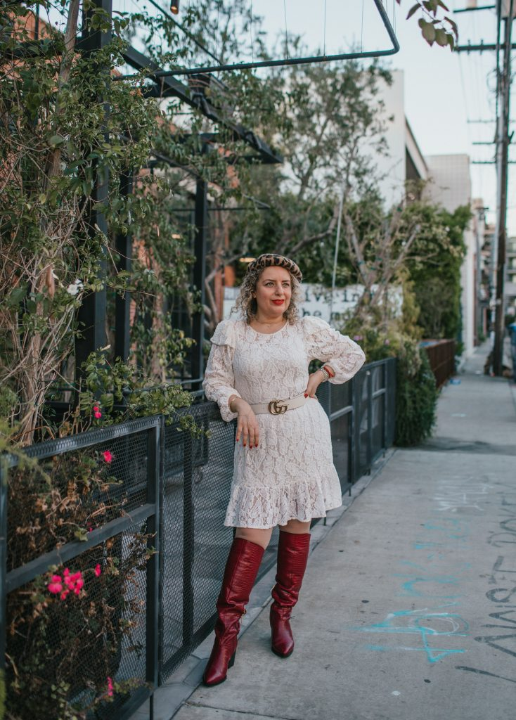 What to Wear on Valentine's Day in 2021: 3 Cute Outfit Ideas, a blog post by Liz in Los Angeles, top Los Angeles lifestyle blogger, an image of a blonde women in a white dress in red boots and beret for Valentine's Day
